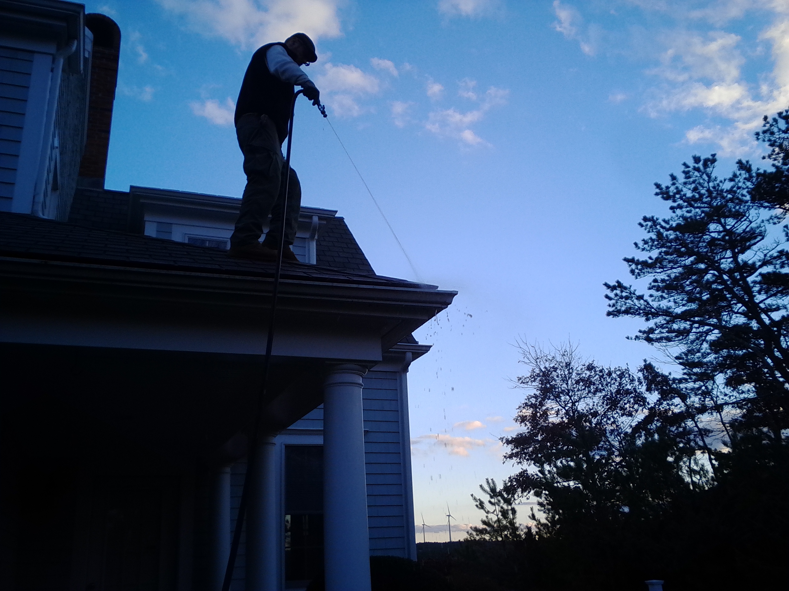 Cleaning gutters in Bourne